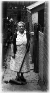 Mrs Bott cleans up the backyard at No. 10 Nursery Street