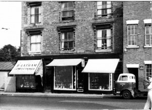 Left to right - Latham's Confectioners, the antiques store, and Walters' Lock Manufacturers shop fronts