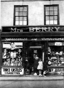 The Berry family and dog outside their shop in North Street  1934